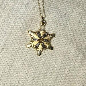 Jewelry - 14 karat gold snowflake pendant with diamonds